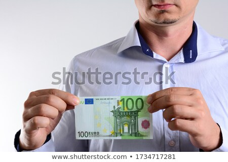 Tax Man holding a handful of 100 euro notes Stock photo © Giulio_Fornasar