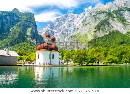 Konigssee Alpine lake and St. Bartholomew church view Stock photo © xbrchx
