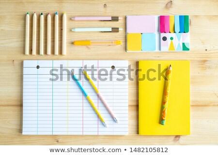 Zsírkréták tollak könyv citromsárga borító lap Stock fotó © pressmaster