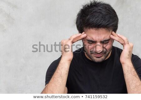 Ongelukkig indian man lijden hoofdpijn mensen Stockfoto © dolgachov