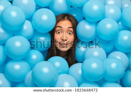 Image of young brunette asian woman expressing surprise with emo Stock photo © deandrobot
