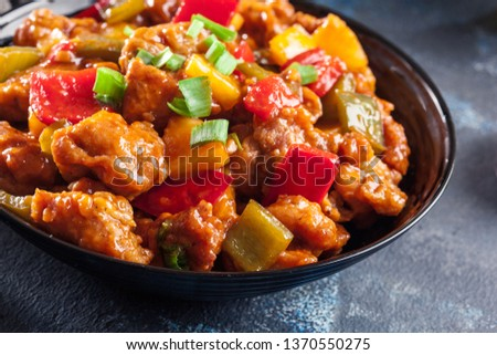 Stock photo: Asian chicken in a sweet and sour sauce