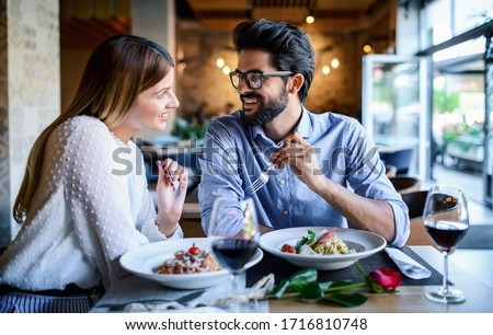 Good food and tasty red wine in a restaurant Stock photo © Kzenon