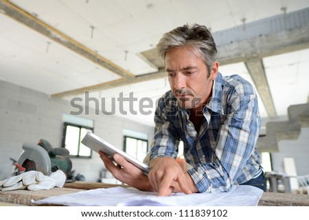 A mature foreman checking plans. Stock photo © photography33