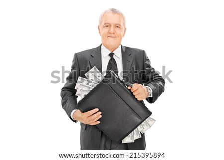 Caucasian businessman with briefcase full of money Stock photo © RAStudio