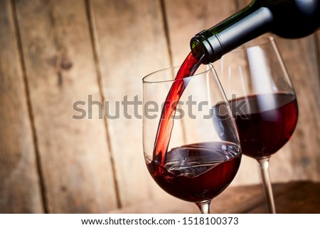 close up of wine bottles in dispenser at bar Stock photo © dolgachov