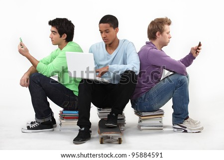 Three teenagers sat working together Stock photo © photography33