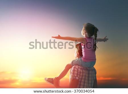 children are enjoying the beautiful sunset  Stock photo © meinzahn