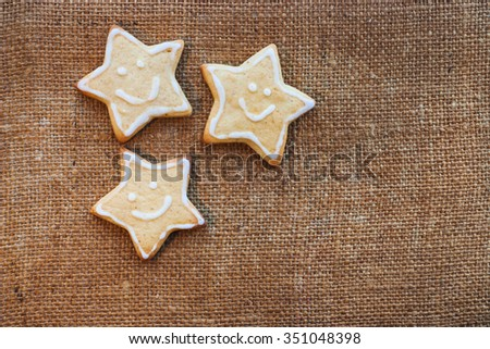 Three christmas cookies on the flax texture Stock photo © Oakozhan