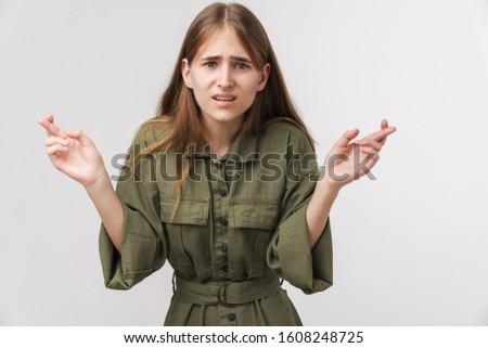 Fotó zavart aranyos nő néz kamera Stock fotó © deandrobot