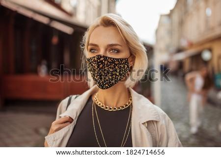 Bella alla moda donna posa nero ragazza Foto d'archivio © iko