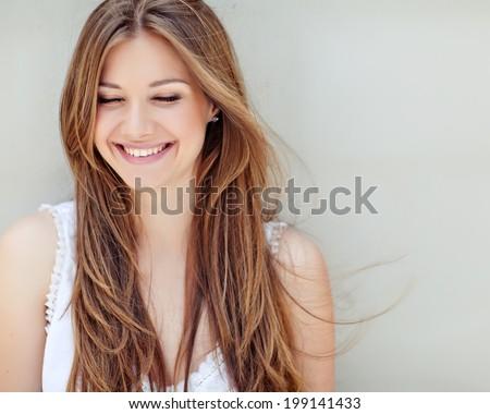 Portrait of beautiful woman smiling Stock photo © wavebreak_media