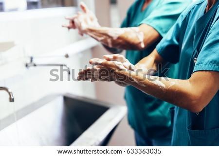 Nurse or doctor washing hands Stock photo © lovleah