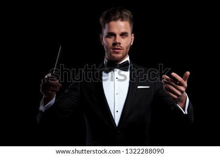 young musician conducting using a stick and gesturing Stock photo © feedough