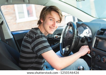 Teenage boy and new driver behind wheel of his car  Stock photo © Lopolo