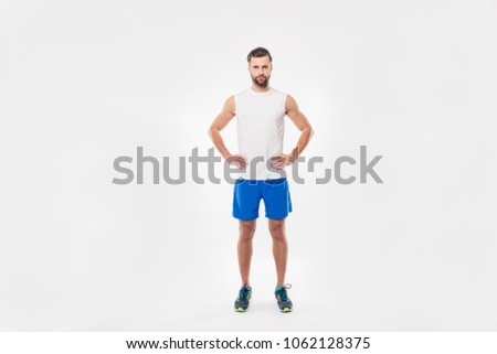 Full-length serious-looking, attractive sportsman in activewear perform side bend exercises, focus o Stock photo © benzoix