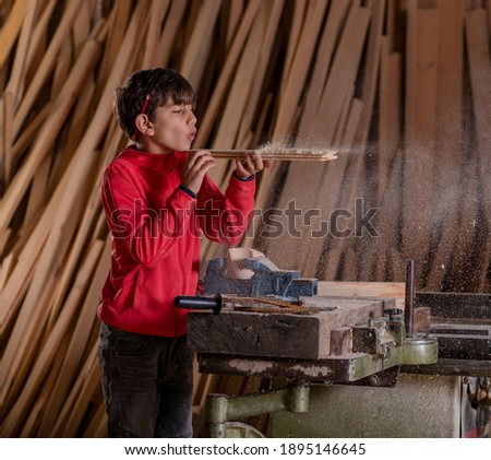 Young boy pretending to be a carpenter Stock photo © Lopolo
