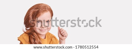 smiling red haired girl showing thumbs up Stock photo © dolgachov