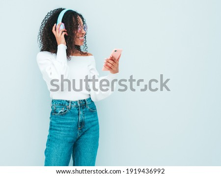 Stock photo: Dancing fun for sexy teenage girl music on phone