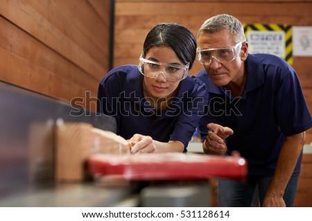 Woman supervising carpenter Stock photo © photography33