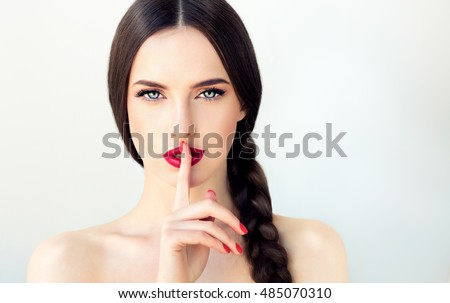 Beautiful woman with finger on lips Stock photo © wavebreak_media