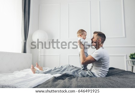 happy father with baby son at home Stock photo © dolgachov