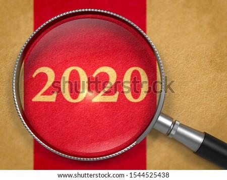 2020 Through Magnifying Glass On Red Paper Business Concept Foto stock © Tashatuvango