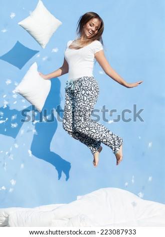 Boldog nő kék ugrik párna jókedv Stock fotó © dolgachov