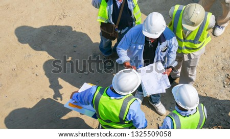Inspector checking progress of construction work Stock photo © jossdiim