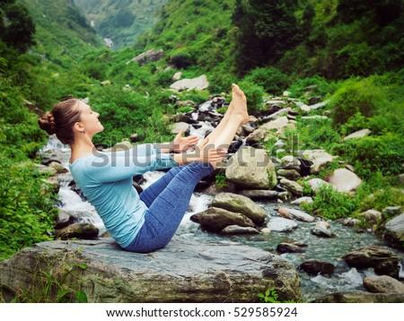 Woman doing Ashtanga Vinyasa Yoga asana Navasana outdoors Stock photo © dmitry_rukhlenko