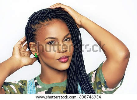 Stock photo: Portrait of young woman with braid hairdo