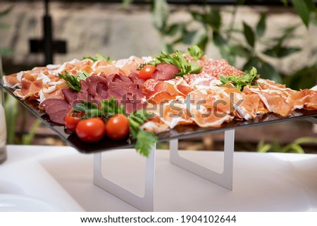 Sliced fresh assorted vegetables and cheese in a glass plate on a gray background. Dietary healthy s Stock photo © artjazz