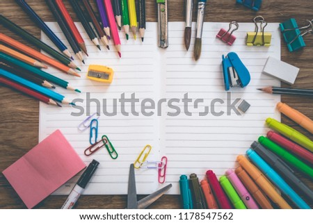 group of stationary office supplies on wooden table stock photo © pressmaster