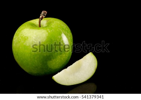 slices of fresh green apples on black background stock photo © lichtmeister