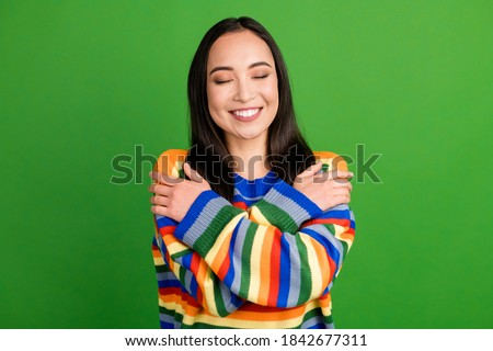 happy woman in striped pullover hugging herself Stock photo © dolgachov