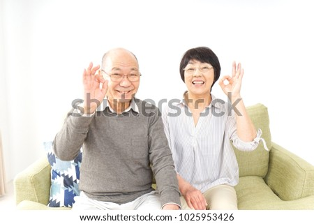 Elderly man giving the a-ok sign Stock photo © photography33