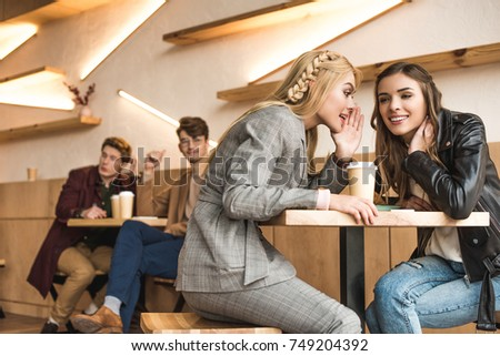 Young women gossiping about a man Stock photo © photography33