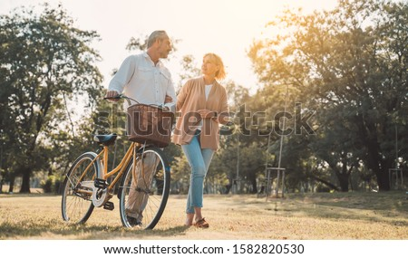 Two Couples Walking with Bicyles in the Park Stock photo © eldadcarin
