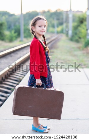 girl and child in valise Stock photo © fanfo