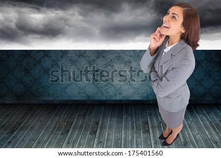 Happy pretty brunette looking beyond  Stock photo © wavebreak_media