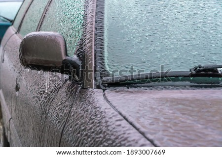 Frozen ice-locked rearview mirror and wiper of the car Stock photo © lightpoet