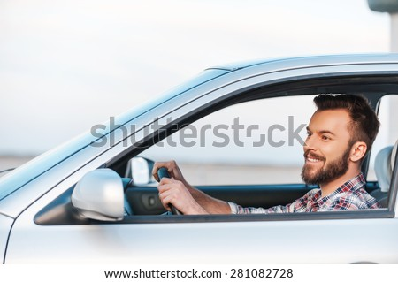 handsome man driving his car stock photo © minervastock
