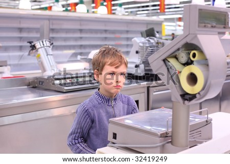 boy looks at scales in empty shop Stock photo © Paha_L