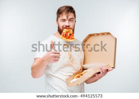 moço · alimentação · fatia · pizza · mãos - foto stock © dolgachov