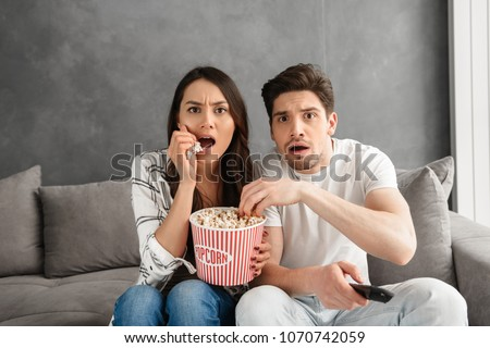 woman eating pop corn while watching movie Stock photo © Lopolo