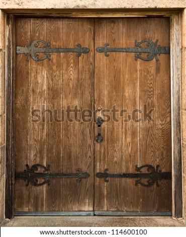 weathered brown wooden door stock photo © rhamm