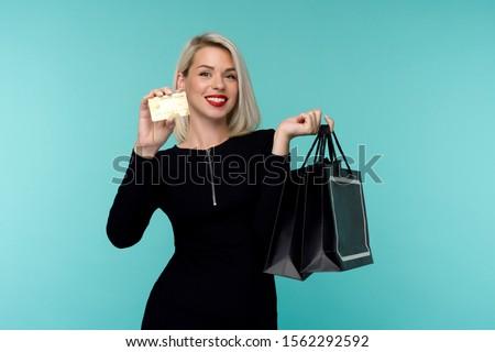 Happy blonde holding shopping bags in white dress Stock photo © wavebreak_media
