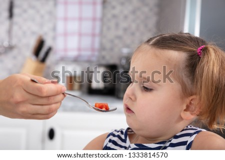 Mother's Hand Feeding Tomato Slice To Her Daughter Stock photo © AndreyPopov