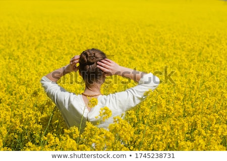 woman enjoying in rapeseed field stock photo © lichtmeister
