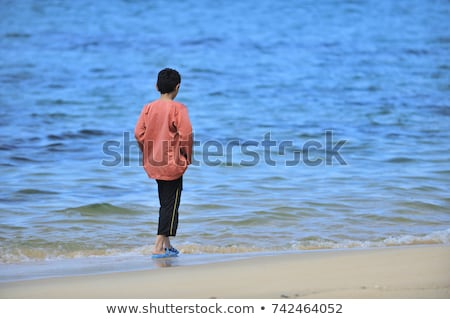 Baby boy walking on the sandy beach near the sea. Cute little kid at sand tropical beach. Stock photo © galitskaya